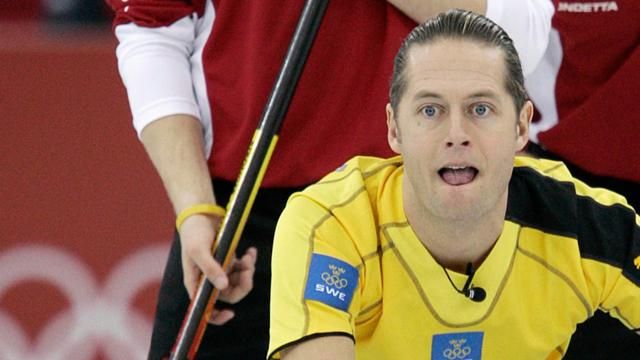 Swedens Peja Lindholm Moved In And Out Of Second Place On A Busy Day At The 2007 Ford World Mens Curling Championship