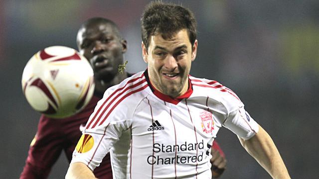 Liverpool claim turgid draw