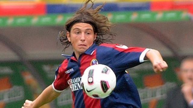 Bologna down 10-man Palermo at death