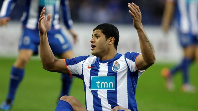 Porto advance despite defeat