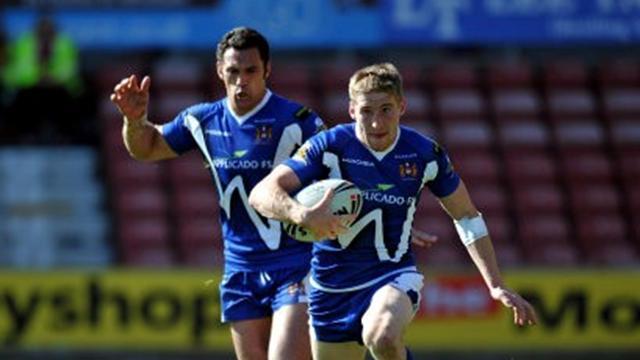 Wigan fight past Bradford into last eight
