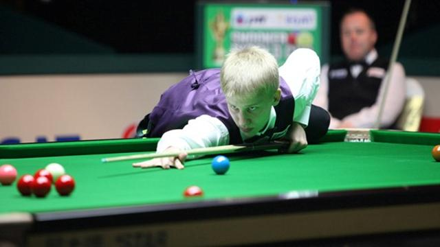 15-year-old beats John Higgins