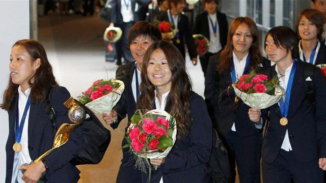 Japan get rock star treatment on return home