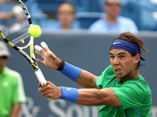 Nadal burns fingers-TENNIS