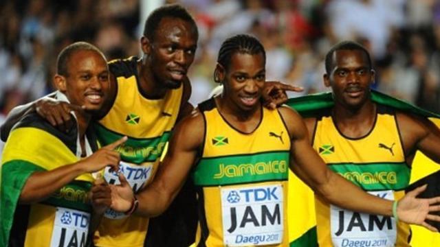 Bolt apologises for podium antics
