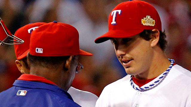 Holland on fire as Rangers tie World Series