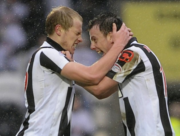St Mirren's Aaron Mooy (L) celebrates his goal with Paul McGowan during their Scottish Premier League soccer match against Rangers at New St Mirren Park, Paisley