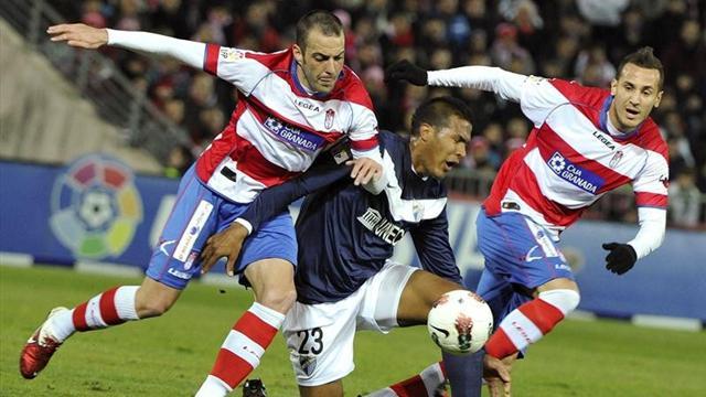 Granada add to Malaga's woes