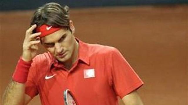 Woe for Federer as Switzerland crash
