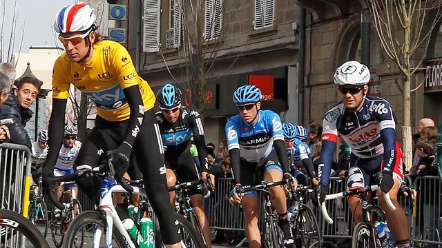 Wiggins retains lead as Meersman wins