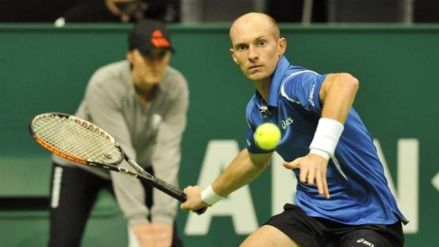 Davydenko sets up clash with Nadal