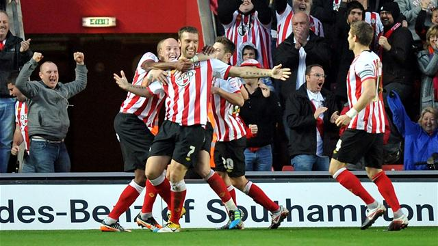 Lambert hat-trick keeps Saints top