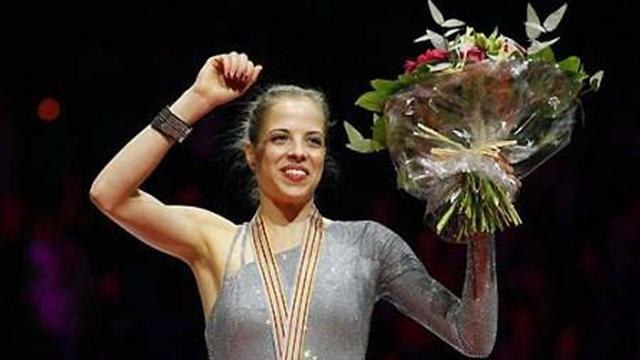 Kostner wins world title at ninth attempt