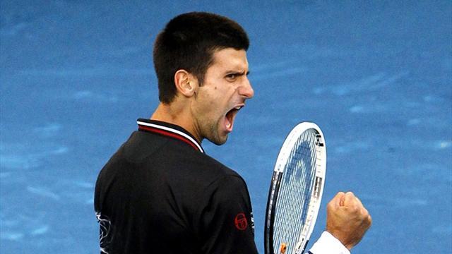 Djokovic advances into last eight