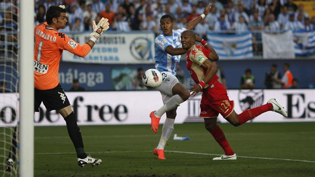 Malaga secure Champions League berth