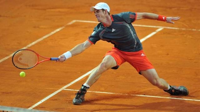 Murray crashes out, Nadal races through