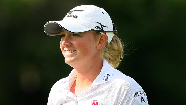 Lewis holds on to Evian lead