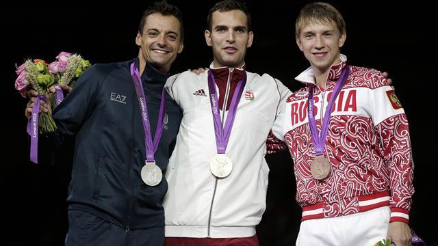 Anthem issues tarnish Hungary Olympic glory