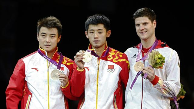 Zhang wins Olympic table tennis title