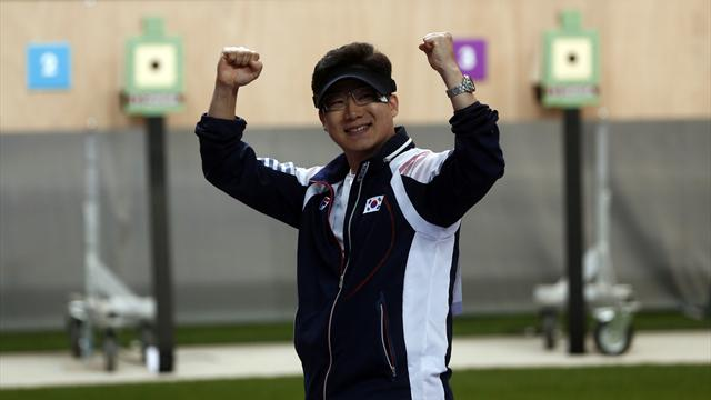 Jin retains Olympic 50m pistol gold