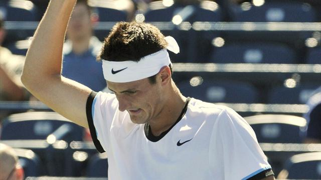 Tomic snaps skid, sets up Toronto tilt with Djokovic