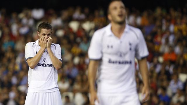 Spurs beaten by Valencia in Spain