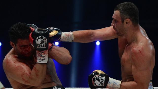 Klitschko defends belt as Charr suffers cut