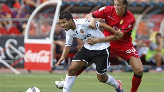 10-man Valencia beat Mallorca and go fifth