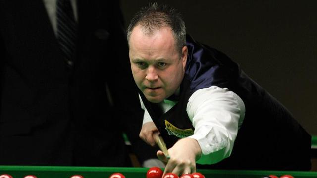 Higgins hits back to sink Carter at Masters