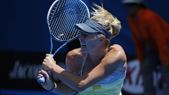 Sharapova through without dropping game