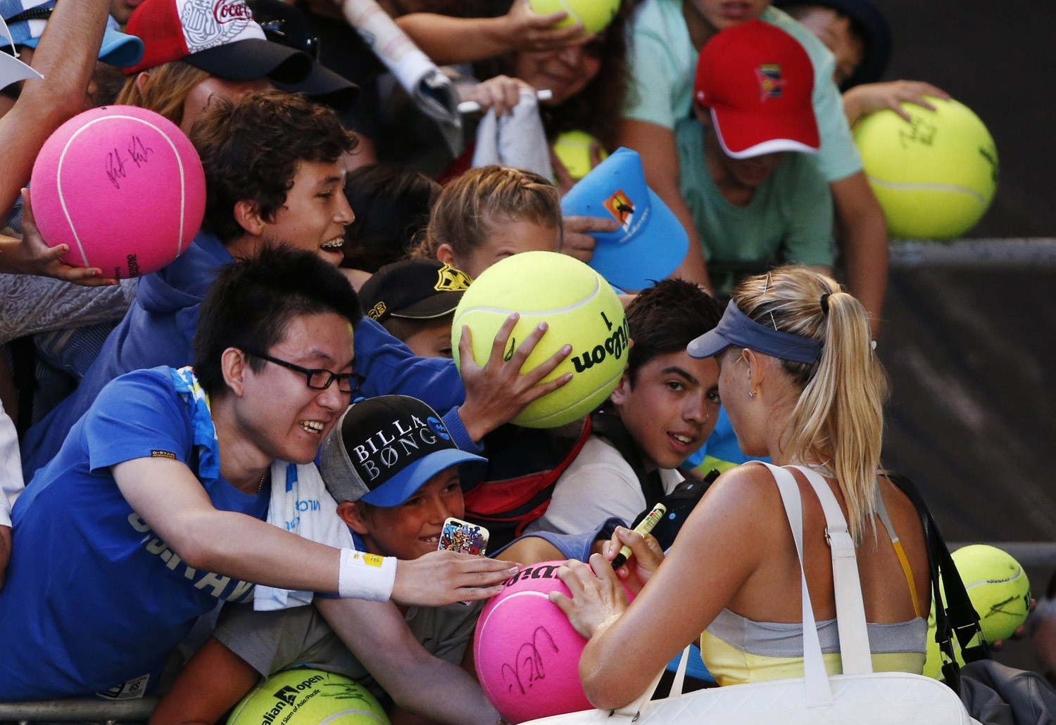 Maria Sharapova of Russia signs autographs for fans after her women's singles match against Misaki Doi of Japan at the Australian Open tennis tournament in Melbourne (Reuters)