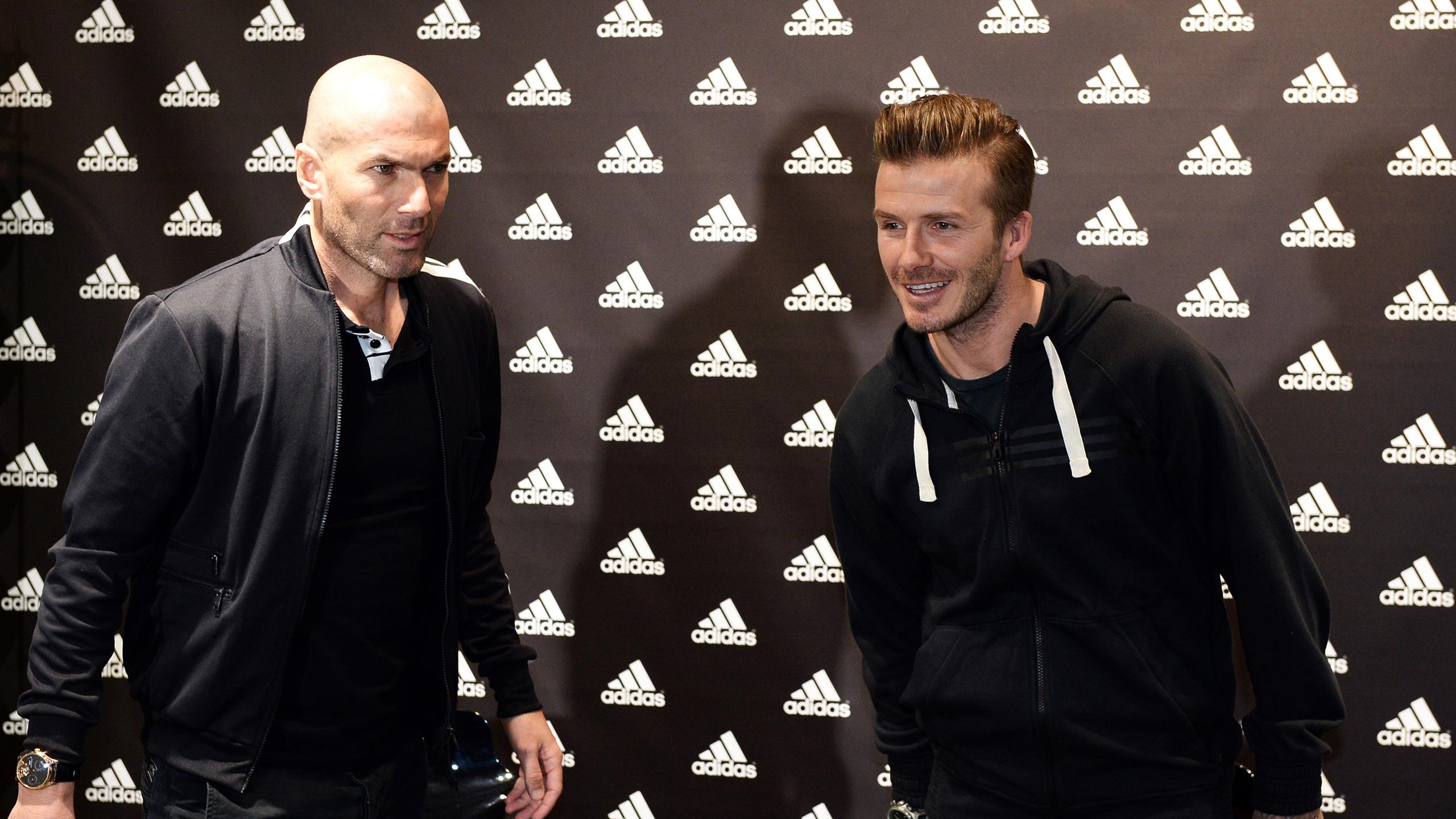 Zinedine Zidane and David Beckham at an event in Paris
