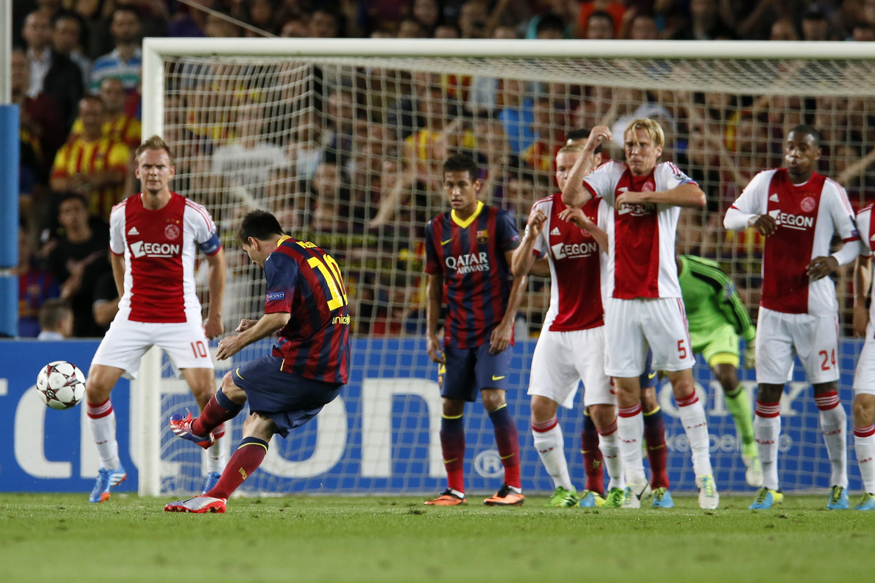 Barcelona's Lionel Messi (2nd L) scores a goal from a direct free kick against Ajax during their Champions League soccer match at Camp Nou stadium in Barcelona September 18, 2013 (Reuters)