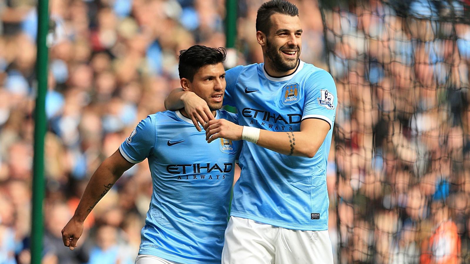 Manchester city s sergio aguero left celebrates with teammate alvaro