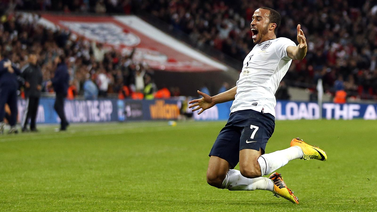 Andros Townsend celebrates scoring his team's third goal during the World Cup 2014 Group H Qualifying football match between England and Montenegro at Wembley Stadium (AFP)