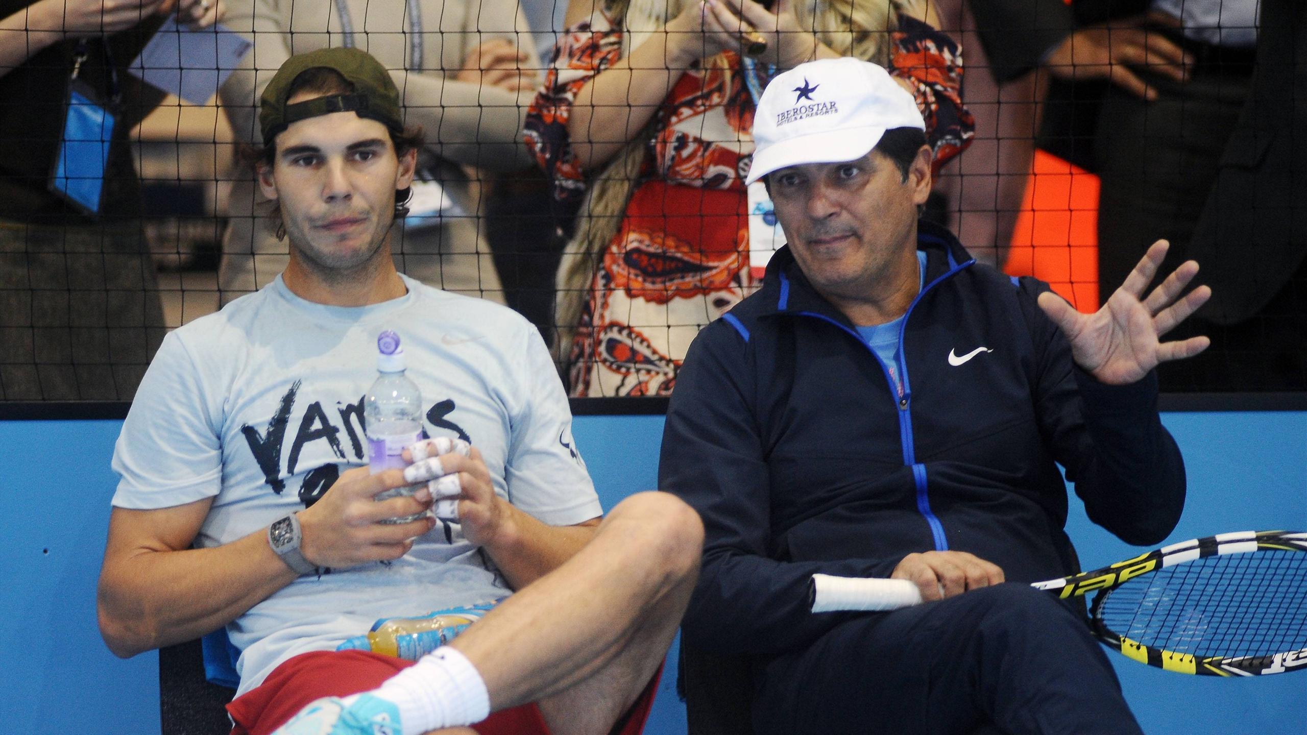 Rafael Nadal (L) and Toni Nadal