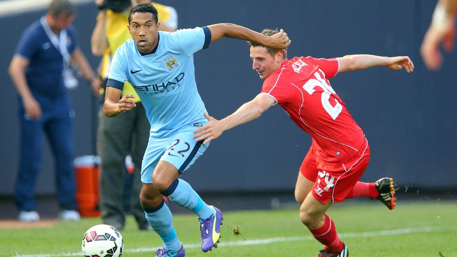 Manchester City defender Gael Clichy in action against Liverpool midfielder Joe Allen at Yankee Stadium (Reuters)