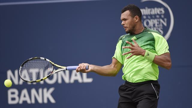 Tsonga battles past Murray to reach semis