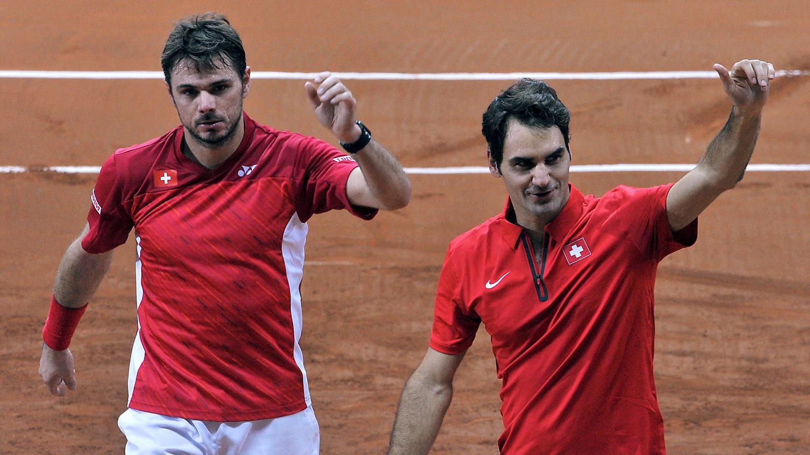 Stan Wawrinka et Roger Federer pendant la finale de double de Coupe Davis
