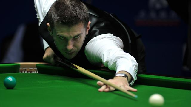 Selby survives Milkins comeback to reach second round