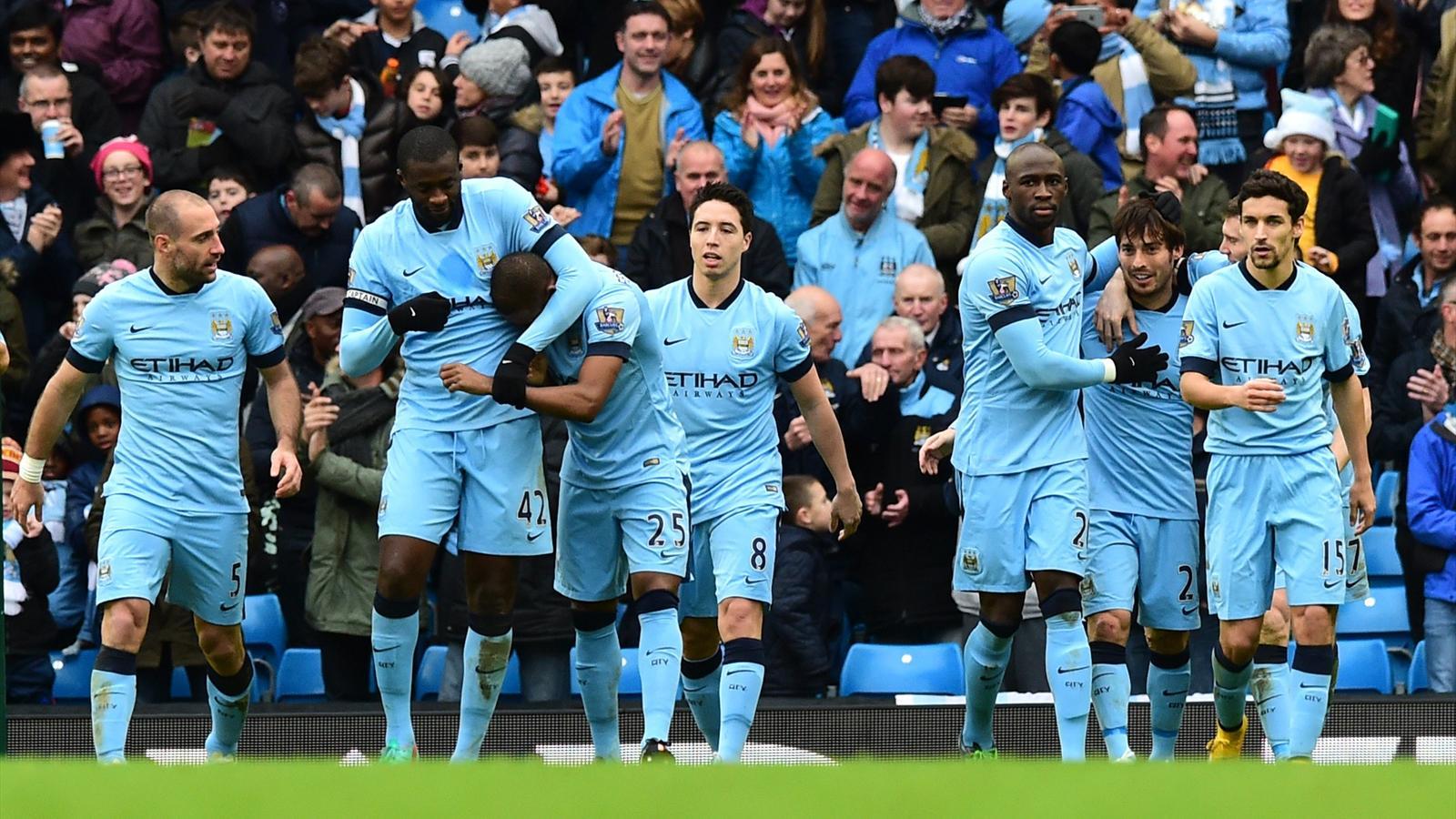 Les joueurs de Manchester City après le but de David Silva - 2014-2015