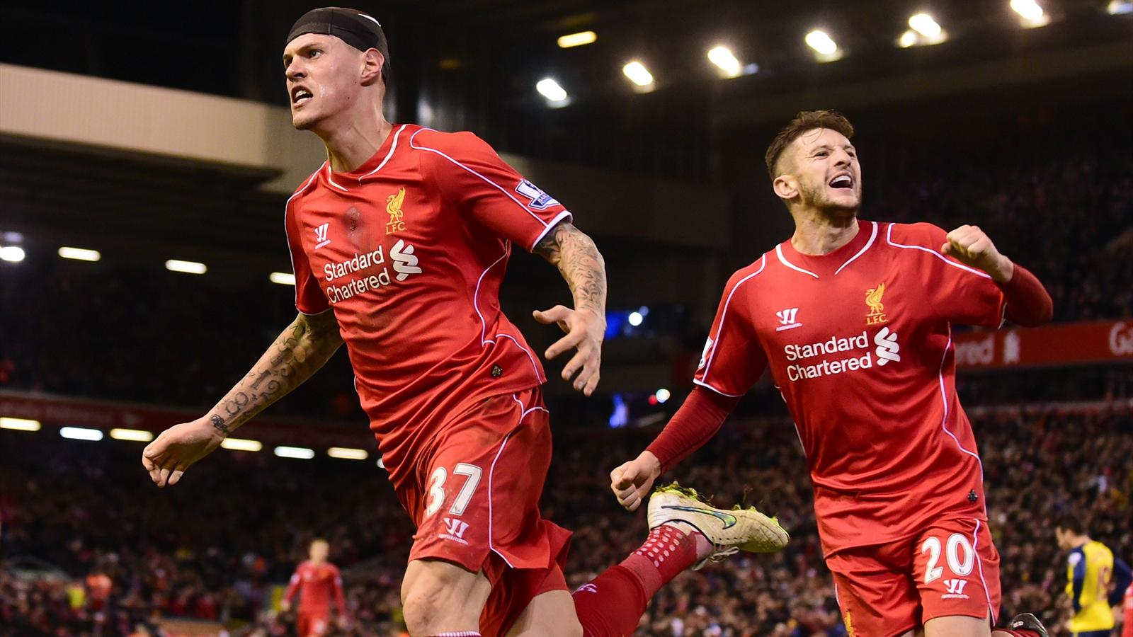 Liverpool's Slovakian defender Martin Skrtel (L) celebrates scoring his team's second equalising goal
