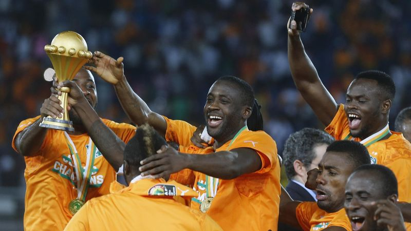Ivory Coast's captain Yaya Toure celebrates with team mates after winning the African Nations Cup final against Ghana