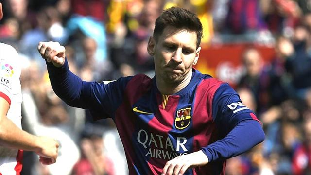 Lionel Messi sends Barcelona top with record hat-trick