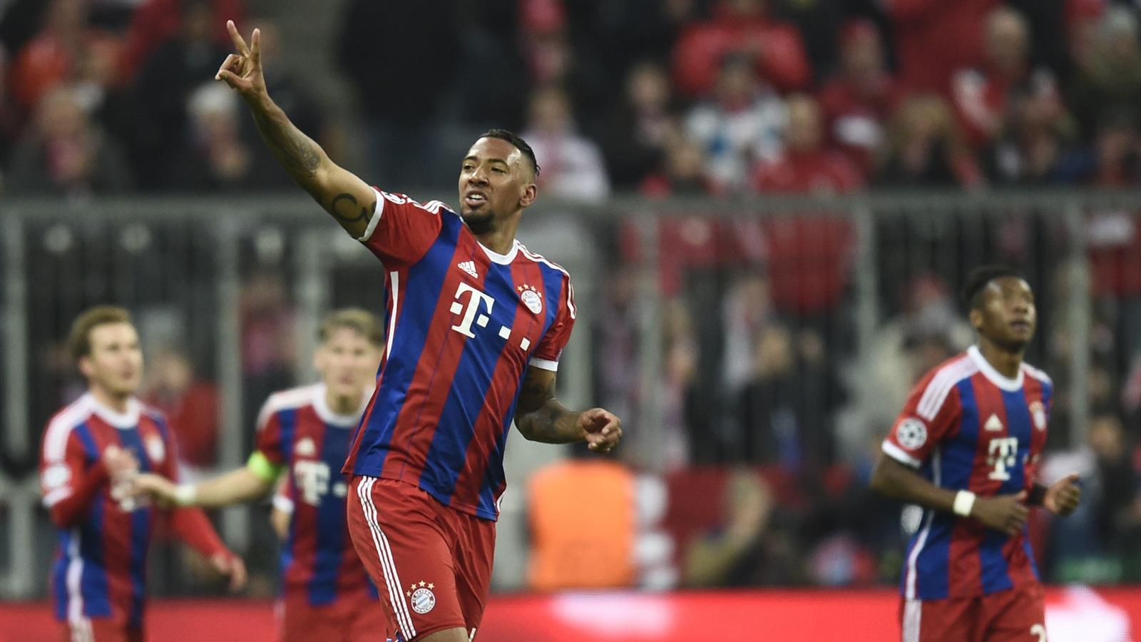 Bayern Munich's defender Jerome Boateng celebrates scoring the 2-0 goal during the UEFA Champions League second-leg, Round of 16 football match FC Bayern Munich vs Shakhtar Donetsk in Munich