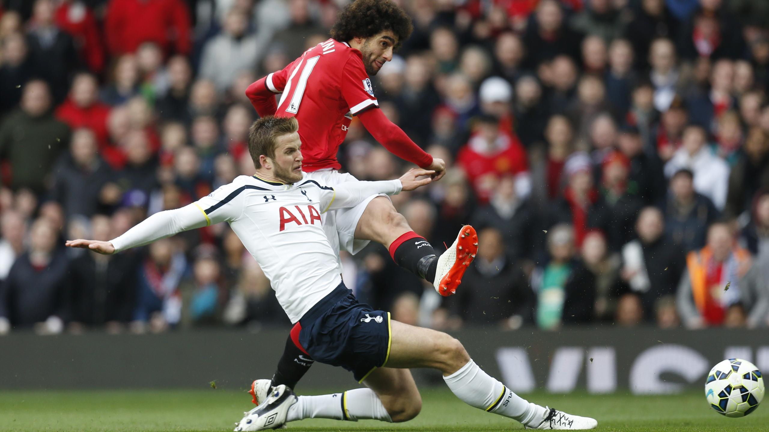 Marouane Fellaini scores Manchester United's opening goal against Tottenham (Reuters)