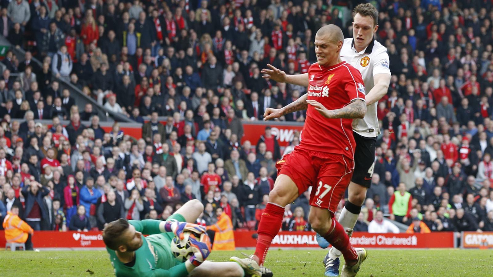 Liverpool's Martin Skrtel challenges Manchester United's David De Gea (Reuters)