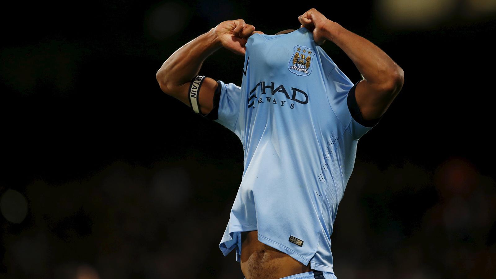 Manchester City's Vincent Kompany looks dejected