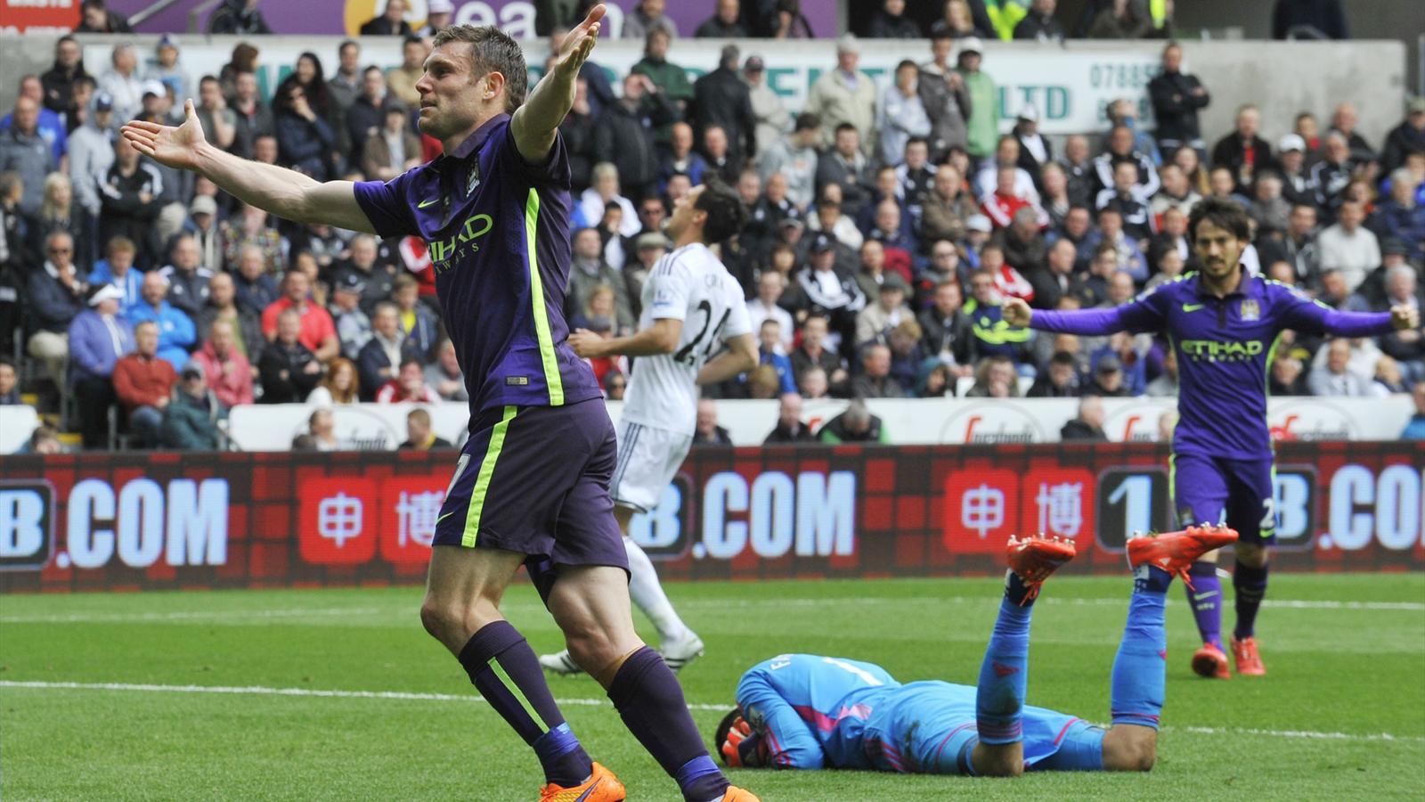James Milner celebrates his goal against Swansea