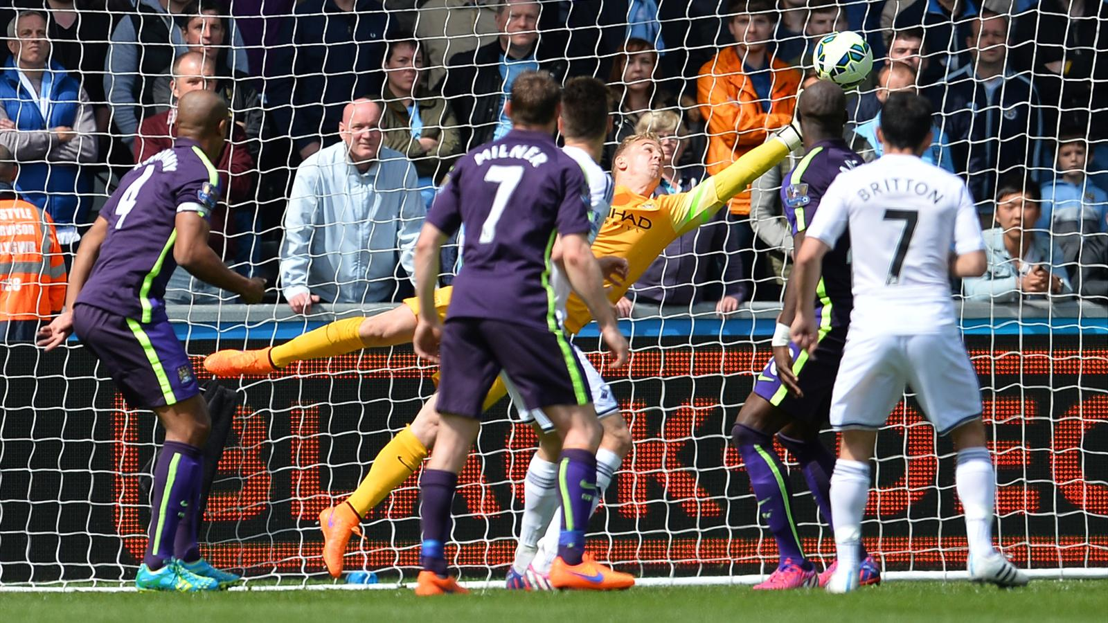 Manchester City goalkeeper Joe Hart makes a brilliant save against Swansea